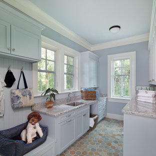 Coastal galley utility room photo in Charleston with an undermount sink, shaker cabinets, blue cabinets and blue walls