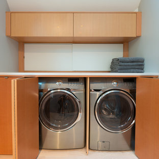Inspiration for a contemporary laundry closet remodel in Vancouver with flat-panel cabinets, medium tone wood cabinets and a side-by-side washer/dryer