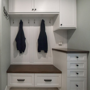 Example of a mid-sized classic galley dark wood floor utility room design in Orange County with shaker cabinets, white cabinets, wood countertops and gray walls