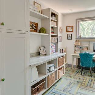 This is an example of a large eclectic single-wall utility room in Grand Rapids with shaker cabinets, grey cabinets, granite worktops, white walls, carpet and a side by side washer and dryer.