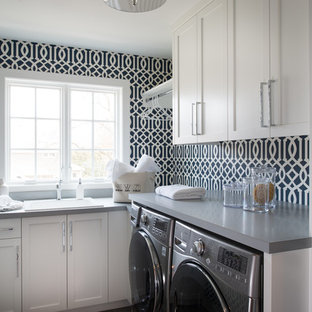 Inspiration for a small transitional l-shaped dedicated laundry room remodel in Minneapolis with a drop-in sink, shaker cabinets, white cabinets, multicolored walls, a side-by-side washer/dryer and gray countertops