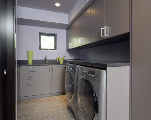 Trendy Laundry Room Photo In Minneapolis With Gray Cabinets And Gray Floors