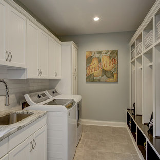 Large classic galley utility room in Dallas with a submerged sink, shaker cabinets, white cabinets, granite worktops, grey walls, porcelain flooring, a side by side washer and dryer, grey floors and grey worktops.