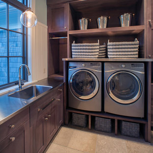 Large traditional l-shaped utility room in Grand Rapids with shaker cabinets, dark wood cabinets, ceramic flooring, a side by side washer and dryer, beige floors, green walls, stainless steel worktops and grey worktops.