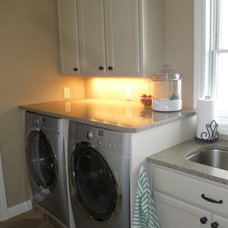 Traditional Laundry Room by River North Construction Group