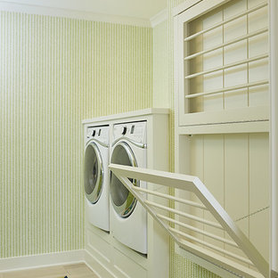 Design ideas for a large traditional single-wall dedicated laundry room in Grand Rapids with recessed-panel cabinets, white cabinets, a side-by-side washer and dryer and multi-coloured floor.