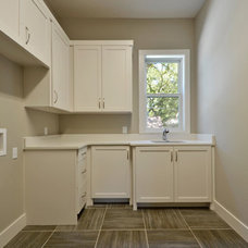 Traditional Laundry Room by Moazami Homes