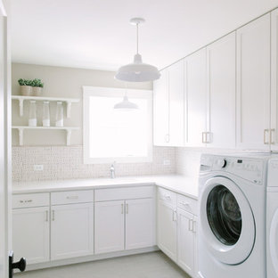 Cottage l-shaped white floor dedicated laundry room photo in Chicago with shaker cabinets, white cabinets, beige walls, a side-by-side washer/dryer and white countertops