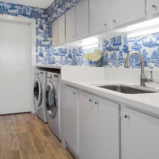 Inspiration for a transitional single-wall medium tone wood floor laundry room remodel in San Diego with an undermount sink, flat-panel cabinets, white cabinets, blue walls and white countertops