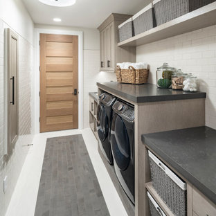 Large cottage galley slate floor and gray floor dedicated laundry room photo in Salt Lake City with granite countertops, a side-by-side washer/dryer, gray countertops, recessed-panel cabinets, gray cabinets and gray walls