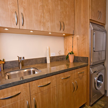European Style Cabinetry in the Laundry Room with Slate Floor