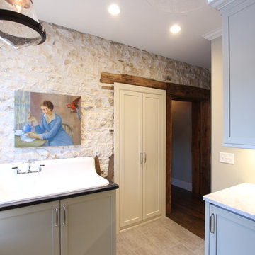 Exposed Stone Wall with Original Timber Doorway in Farmhouse Laundry Room