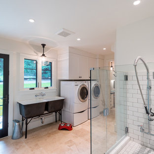 Inspiration for a large country single-wall utility room in San Francisco with an utility sink, shaker cabinets, white cabinets, a side by side washer and dryer, white walls, porcelain flooring and beige floors.