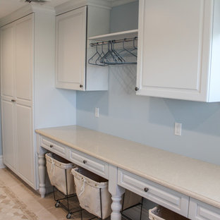 Utility room - large shabby-chic style galley ceramic floor utility room idea in New York with a drop-in sink, white cabinets, blue walls and raised-panel cabinets