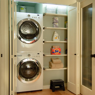 Design ideas for a transitional laundry room in Seattle with a stacked washer and dryer.