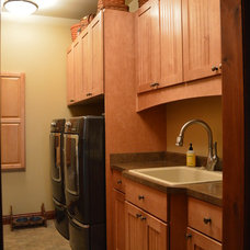 Farmhouse Laundry Room by Castle Kitchens and Interiors