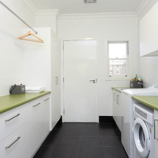 Mid-sized minimalist galley ceramic tile dedicated laundry room photo in Brisbane with a drop-in sink, flat-panel cabinets, white cabinets, white walls, green countertops and laminate countertops