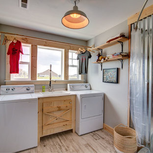 Utility room - farmhouse single-wall light wood floor and beige floor utility room idea in Other with a drop-in sink, light wood cabinets, gray walls, a side-by-side washer/dryer and beige countertops