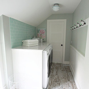 Design ideas for a small rural single-wall separated utility room in Chicago with raised-panel cabinets, white cabinets, marble worktops, porcelain flooring, a side by side washer and dryer and grey walls.