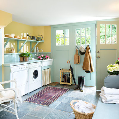 Inspiration for a farmhouse utility room remodel in Other with a farmhouse sink, open cabinets, yellow walls and a side-by-side washer/dryer