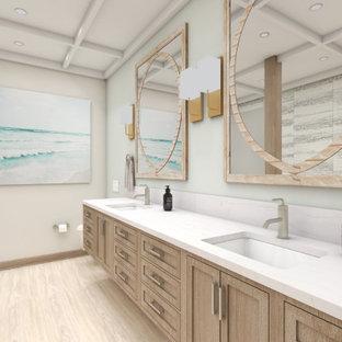Bild på ett mellanstort lantligt vit parallellt vitt grovkök, med en undermonterad diskho, luckor med profilerade fronter, vita skåp, bänkskiva i kvarts, beige väggar, tegelgolv, en tvättmaskin och torktumlare bredvid varandra och rosa golv