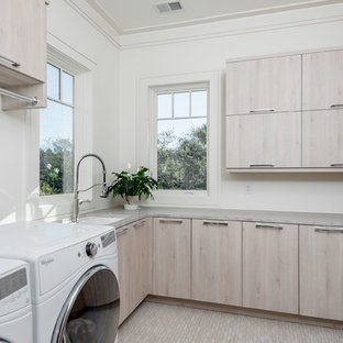 Mid-sized trendy u-shaped beige floor and porcelain floor dedicated laundry room photo in Charleston with an undermount sink, flat-panel cabinets, light wood cabinets, white walls, gray countertops and quartzite countertops