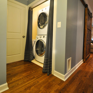 Inspiration for a transitional medium tone wood floor laundry closet remodel in DC Metro with blue walls