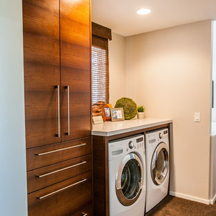 Design ideas for a small contemporary single-wall dedicated laundry room in Salt Lake City with flat-panel cabinets, dark wood cabinets, quartz benchtops, beige walls, a side-by-side washer and dryer and carpet.