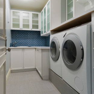Photo of a laundry room in Toronto with blue splashback.