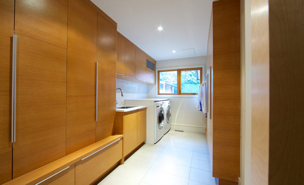 Modern Laundry Room by Lacey Construction Ltd.