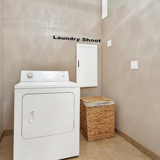This is an example of a large retro l-shaped separated utility room in Los Angeles with a built-in sink, shaker cabinets, white cabinets, quartz worktops, orange walls, ceramic flooring, a side by side washer and dryer, beige floors and white worktops.