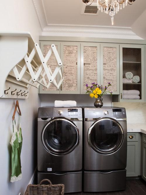 Dedicated laundry room - traditional black floor dedicated laundry room  idea in San Francisco with recessed