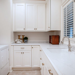Inspiration for a mid-sized timeless u-shaped beige floor and ceramic tile dedicated laundry room remodel in Milwaukee with an undermount sink, recessed-panel cabinets, white cabinets, quartz countertops, a side-by-side washer/dryer, white countertops and white walls