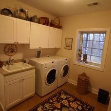 Farmhouse Laundry Room by Matthew Bowe Design Build, LLC