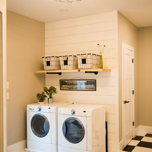 Photo of a small farmhouse single-wall separated utility room in Other with a double-bowl sink, beige walls, vinyl flooring, a side by side washer and dryer and multi-coloured floors.