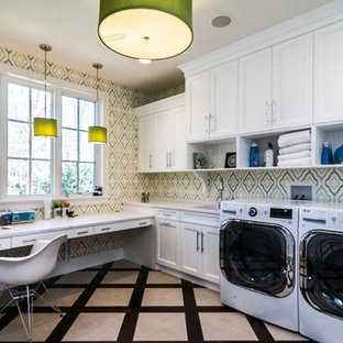 Inspiration for a transitional l-shaped multicolored floor utility room remodel in Chicago with shaker cabinets, white cabinets, multicolored walls, a side-by-side washer/dryer and white countertops