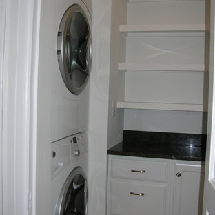 Photo of a large victorian utility room in Boston with dark hardwood flooring.