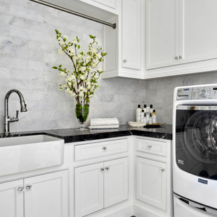 Laundry room - french country laundry room idea in Orange County