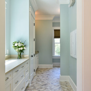 Inspiration for a mid-sized transitional l-shaped porcelain tile and multicolored floor utility room remodel in Charleston with an undermount sink, shaker cabinets, beige cabinets, quartz countertops, blue walls, a side-by-side washer/dryer and beige countertops