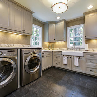 Dedicated laundry room - farmhouse u-shaped dedicated laundry room idea in Tampa with a single-bowl sink, gray cabinets and a side-by-side washer/dryer