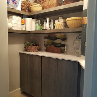 Utility room - mid-sized contemporary single-wall porcelain tile and beige floor utility room idea in Chicago with an undermount sink, flat-panel cabinets, gray cabinets, a side-by-side washer/dryer, quartz countertops and beige walls