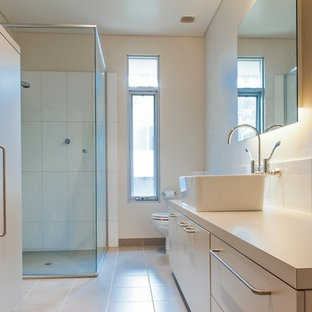 Example of a small trendy galley porcelain tile utility room design in Perth with a farmhouse sink, laminate countertops and a side-by-side washer/dryer