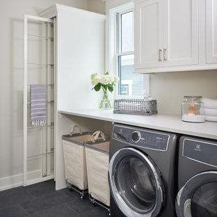 Idéer för mellanstora lantliga parallella vitt tvättstugor enbart för tvätt, med luckor med infälld panel, vita skåp, bänkskiva i kvarts, vita väggar, skiffergolv, en tvättmaskin och torktumlare bredvid varandra och blått golv