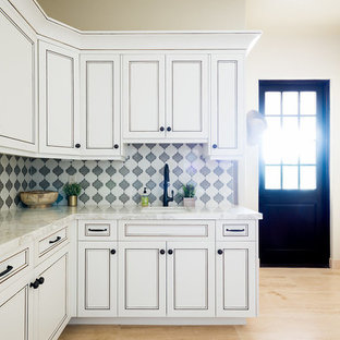 Example of a mid-sized tuscan u-shaped beige floor utility room design in San Luis Obispo with an undermount sink, shaker cabinets, white cabinets, marble countertops and beige walls
