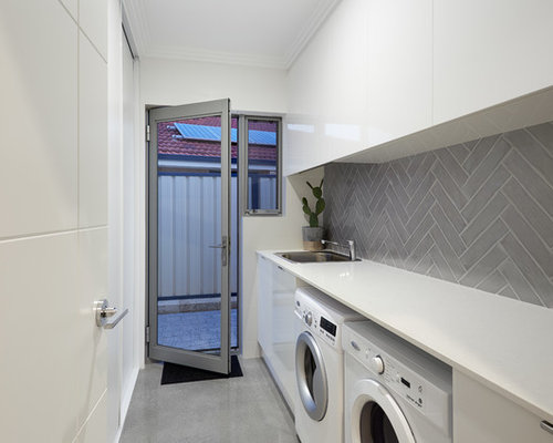 Galley Laundry Room Design Ideas, Remodels & Photos with Concrete Floors