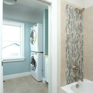 Laundry room - traditional gray floor laundry room idea in Minneapolis with a stacked washer/dryer