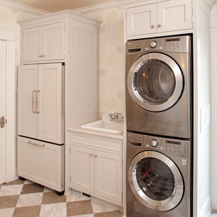 Laundry room - traditional multicolored floor laundry room idea in Minneapolis with a drop-in sink and a stacked washer/dryer