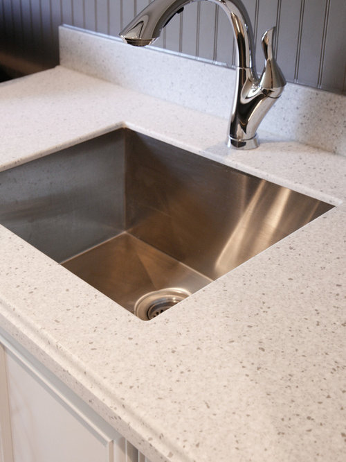Minimalist Laundry Room Photo In Atlanta With Solid Surface Countertops