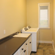 Traditional Laundry Room by Sunrise Builders of Marquette, Inc.