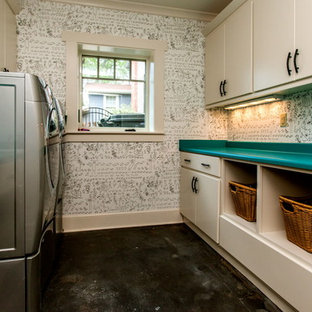 Example of a transitional concrete floor laundry room design in Other with turquoise countertops
